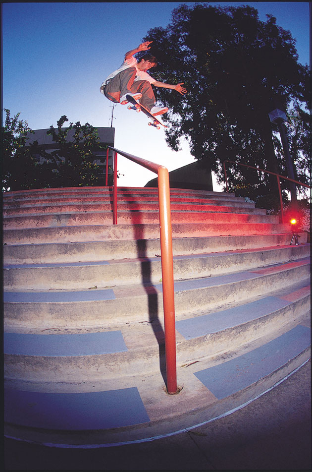 Tom Penny frontside flips over the red light district.